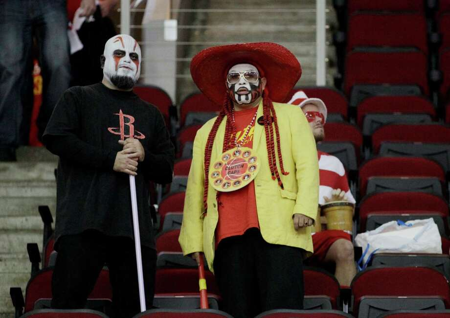 David Gonzalez and Jesse Torres wait for the start of an NBA game between the Houston Rockets and the Golden State Warriors at the Toyota Center, Friday, Oct. 30, 2015, in Houston. Photo: Jon Shapley, Houston Chronicle / © 2015  Houston Chronicle