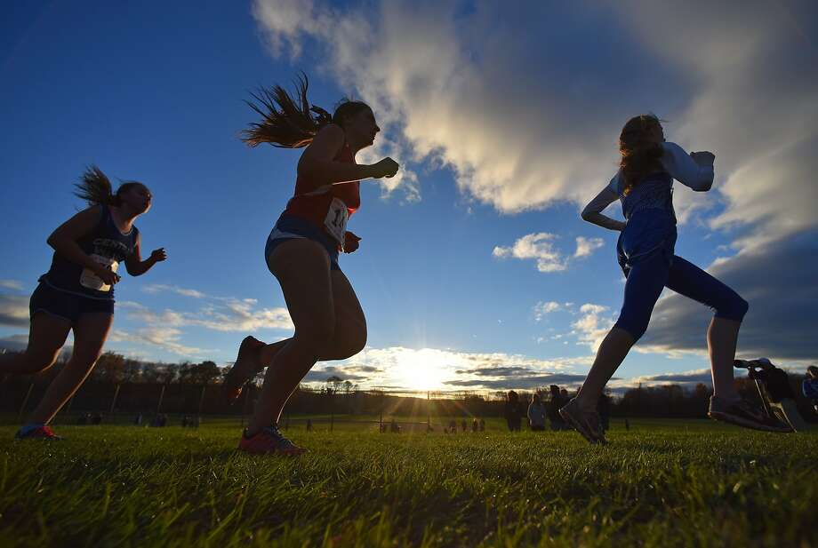 High schools throughout Central New York compete 40-degree conditions in cross country Tri-Valley League Championships, Friday, Oct. 30, 2015 at Ralph Perry Junior High School in New Hartford, N.Y. Friday's weather brought mostly sunny conditions and temperatures in the mid 40s throughout Central New York. Photo: Mark DiOrio, Associated Press