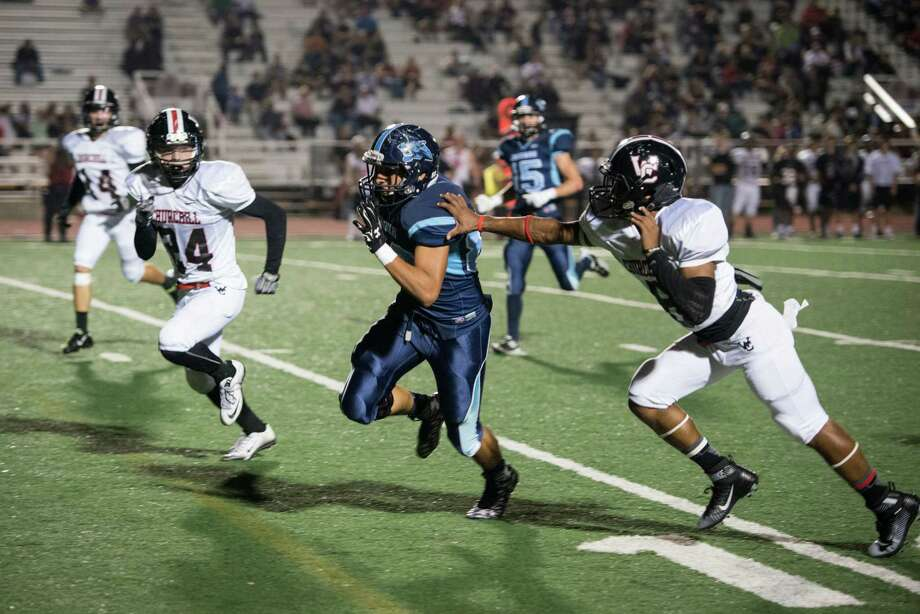 Johnson's Zayed Arrredondo carries the ball during the District 26-6A high school football game between Johnson and Churchill at Comalander Stadium in San Antonio on Friday, October 30, 2015. Photo: Matthew Busch, For The San Antonio Express-News / © Matthew Busch 2015