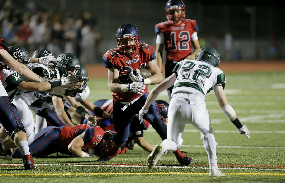 Campolindo running back Jack Cassidy, 24 on a run in the second quarter, as Campolindo Cougars take on the the Miramonte Matadors in Moraga, Calif. on Fri. October 30, 2015.