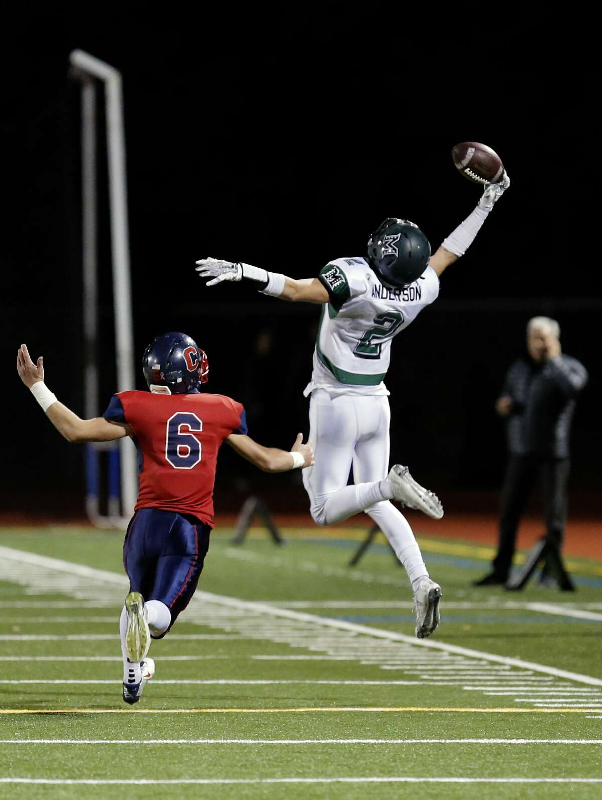 Miramonte receiver Ryan Anderson, 2 can't hold onto a second quarter pass as he is covered by Campolindo's Devin Regan, 6 as Campolindo Cougars take on the the Miramonte Matadors in Moraga, Calif. on Fri. October 30, 2015.