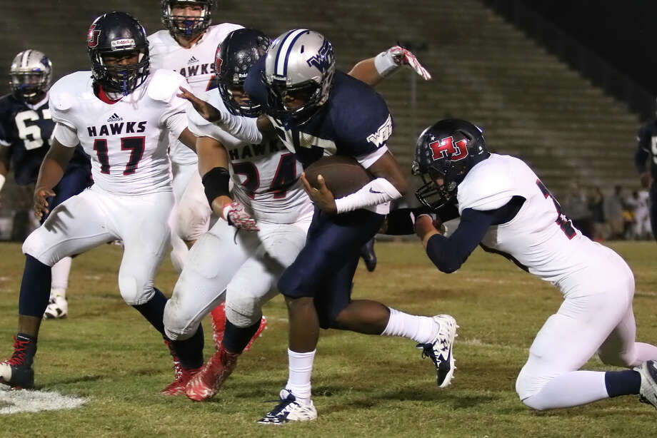 Keion Hancock runs through the Hawk defense during the game between the WO-S Mustangs and the Hardin Jefferson Hawks at Dan R. Hooks Stadium in Orange, Friday night October 30th, 2015 - Photo provided by Kyle Ezell