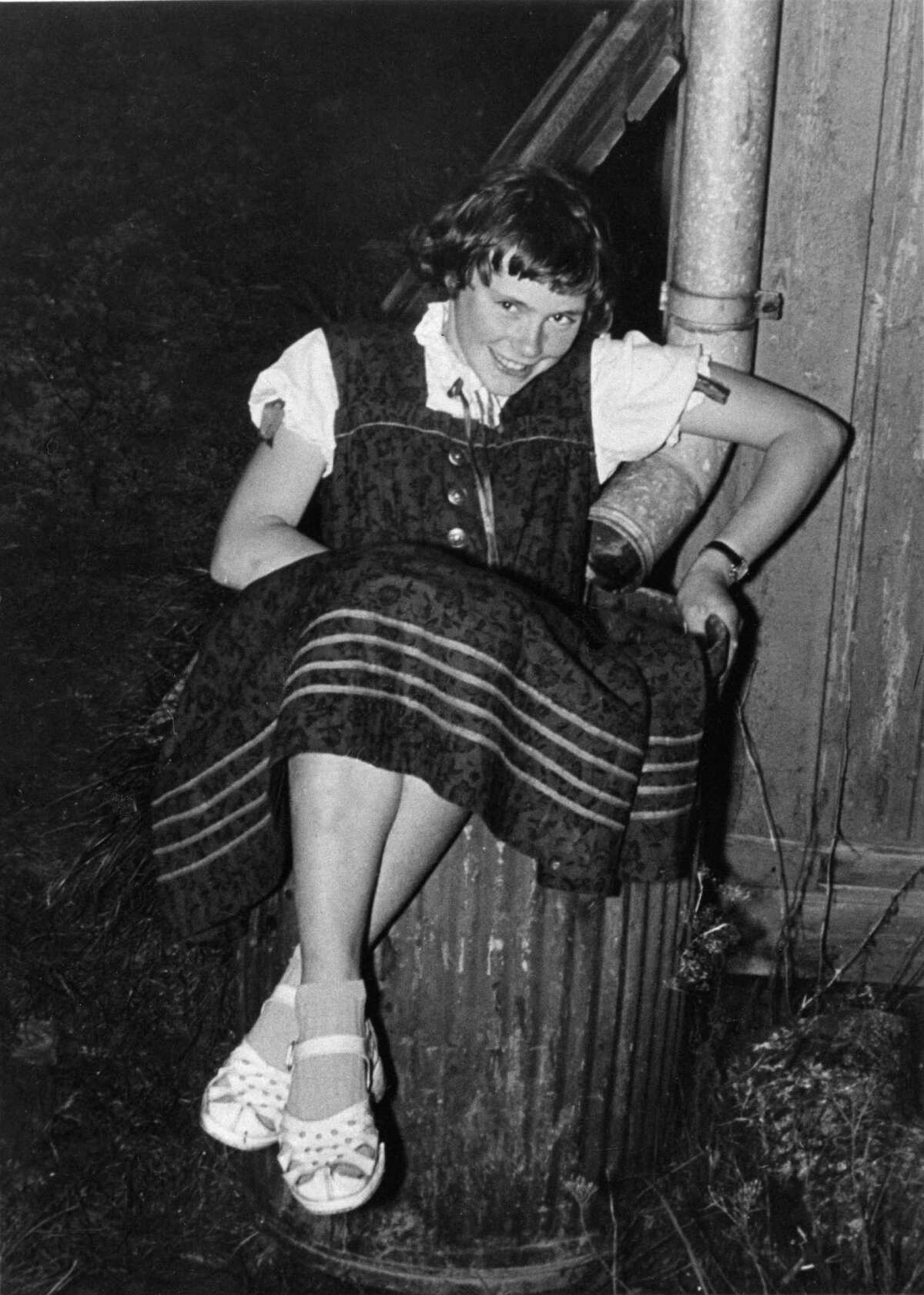 July 1, 1957: Born in Berlin on Nov. 5, 1940, Sommer, an only child, is seen sitting in a rain barrel at the tender age of 16. She and her parents escaped the ravages of World War II by moving to the south of Germany; she later moved to England to work as an au pair and learn English. She now knows seven languages.