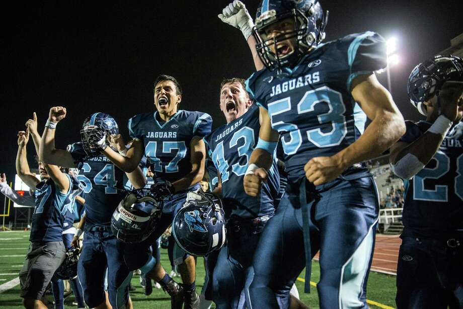 Johnson's sideline celebrates a touchdown at the half during the District 26-6A high school football game between Johnson and Churchill at Comalander Stadium in San Antonio on Friday, October 30, 2015. Photo: Matthew Busch, Photographer / For The San Antonio Express-News / © Matthew Busch 2015