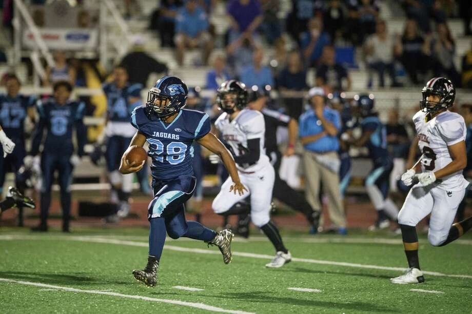 Jaguars' Anthony Hendrix carries the ball for a touchdown in the first half during the District 26-6A high school football game between Johnson and Churchill at Comalander Stadium in San Antonio on Friday, October 30, 2015. Photo: Matthew Busch, Photographer / For The San Antonio Express-News / © Matthew Busch 2015