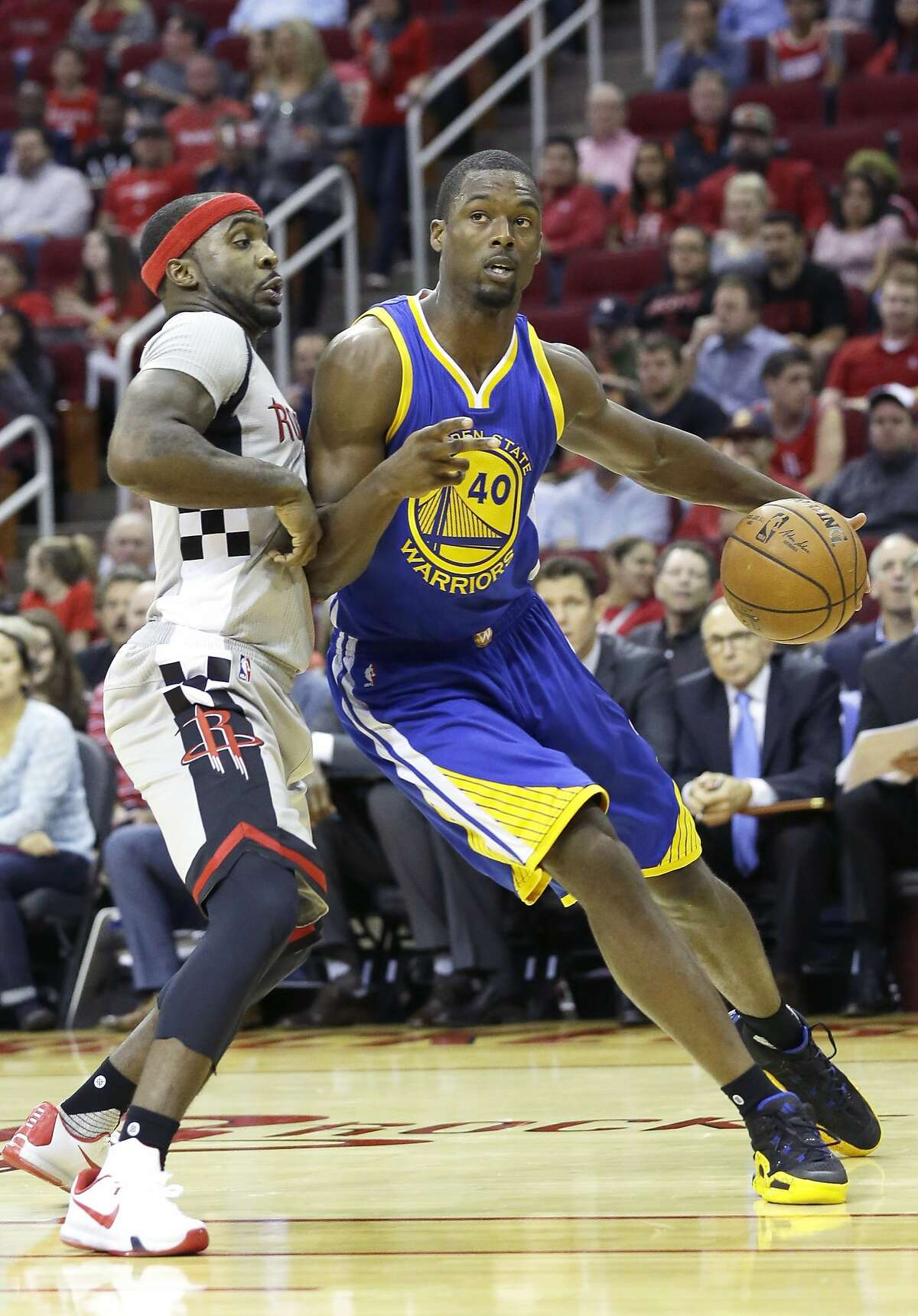 Golden State Warriors' Harrison Barnes (40) is defended by Houston Rockets' Ty Lawson in the first half of a NBA basketball game Friday, Oct. 30, 2015, in Houston. (AP Photo/Pat Sullivan)