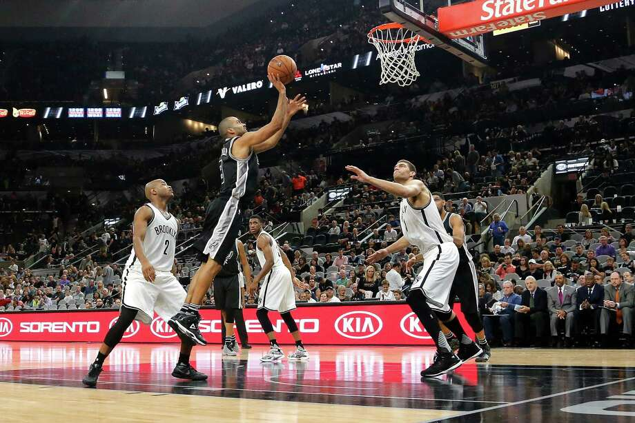 SAN ANTONIO, TX - OCTOBER 30: Tony Parker #9 of the San Antonio Spurs shoots the ball against the Brooklyn Nets at the AT&T Center on October 30, 2015 in San Antonio, Texas. NOTE TO USER: User expressly acknowledges and agrees that, by downloading to the terms and conditions of the Getty Images License Agreement. Photo: Chris Covatta, Getty Images / 2015 Chris Covatta