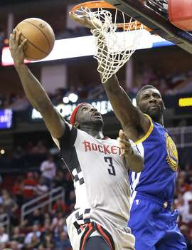 Houston Rockets' Ty Lawson (3) goes to the basket guarded by Golden State Warriors' Festus Ezeli (31) in the second half of an NBA basketball game Friday, Oct. 30, 2015, in Houston. The Warriors won 112-92. (AP Photo/Pat Sullivan)