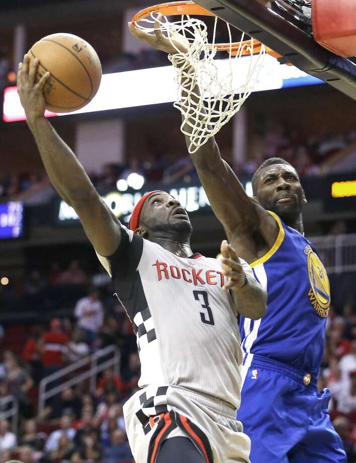 Houston Rockets' Ty Lawson (3) goes to the basket guarded by Golden State Warriors' Festus Ezeli (31) in the second half of an NBA basketball game Friday, Oct. 30, 2015, in Houston. The Warriors won 112-92. (AP Photo/Pat Sullivan) Photo: Pat Sullivan, Associated Press