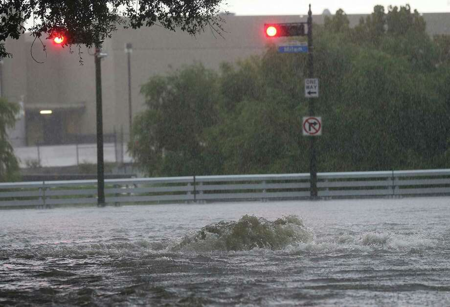 heavy rains flood houston on halloween morning houston chronicle