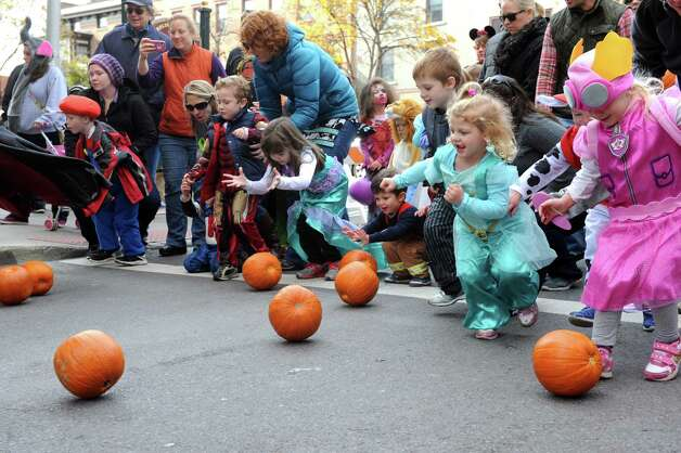 Children compete in the pumpkin roll on Caroline Street during the 14th Annual Saratoga Downtown Business Association Fall Festival on Saturday Oct. 31, 2015 in Saratoga Springs, N.Y. (Michael P. Farrell/Times Union) Photo: Michael P. Farrell / 00034009A
