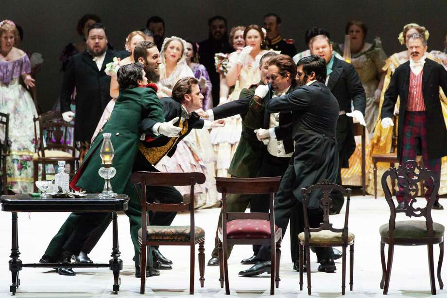 "The fatal quarrel erupts between Lensky (Norman Reinhardt, being held back on left) and Onegin (Scott Hendricks, being restrained on right) in ""Eugene Onegin"" at Houston Grand Opera. Photo: Lynn Lane / Lynn Lane"