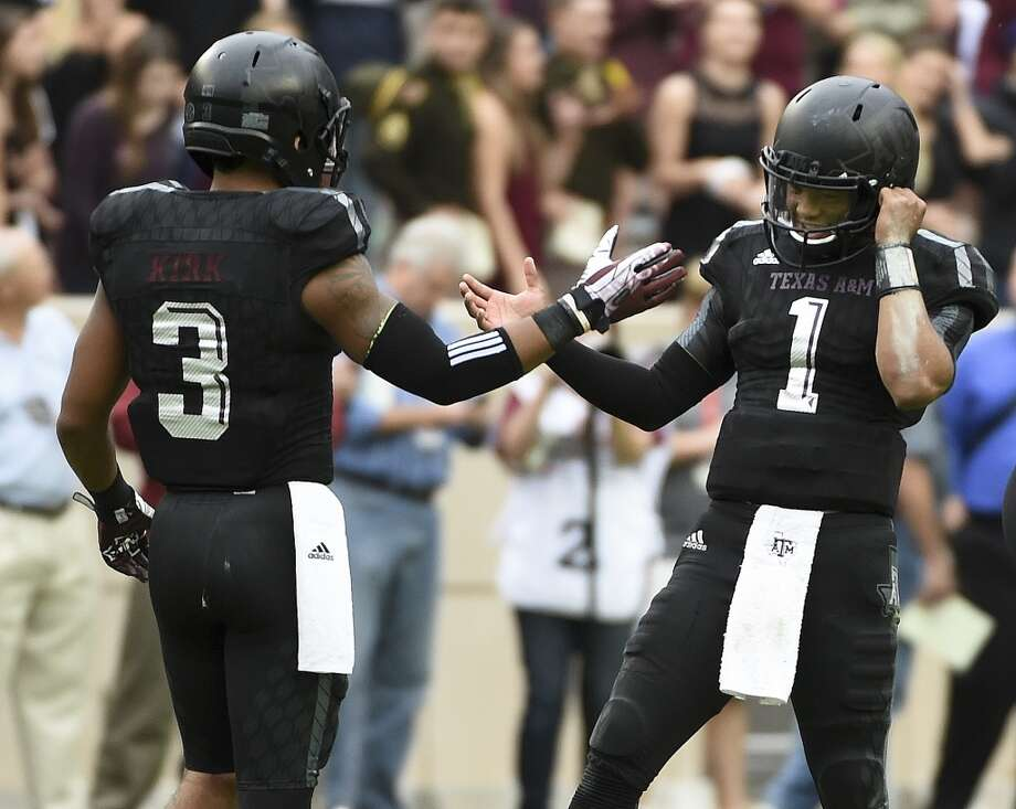 COLLEGE STATION, TX - OCTOBER 31: Kyler Murray #1 and Christian Kirk #3 of the Texas A&M Aggies celebrate the Aggies' 35-28 victory over the South Carolina Gamecocks in a NCAA football game at Kyle Field on October 31, 2015 in College Station, Texas. (Photo by Eric Christian Smith/Getty Images) Photo: Eric Christian Smith, Getty Images