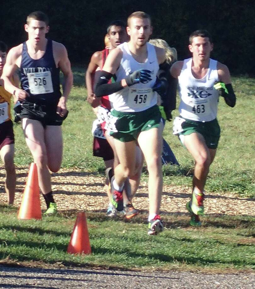 New Milford's Stosh Davis (458) and Lucas Simmonds (463) approach the halfway point of the Class L state cross country championship race at Wickham Park on Oct. 31, 2015. Photo: Rich Gregory / Rich Gregory / News-Times