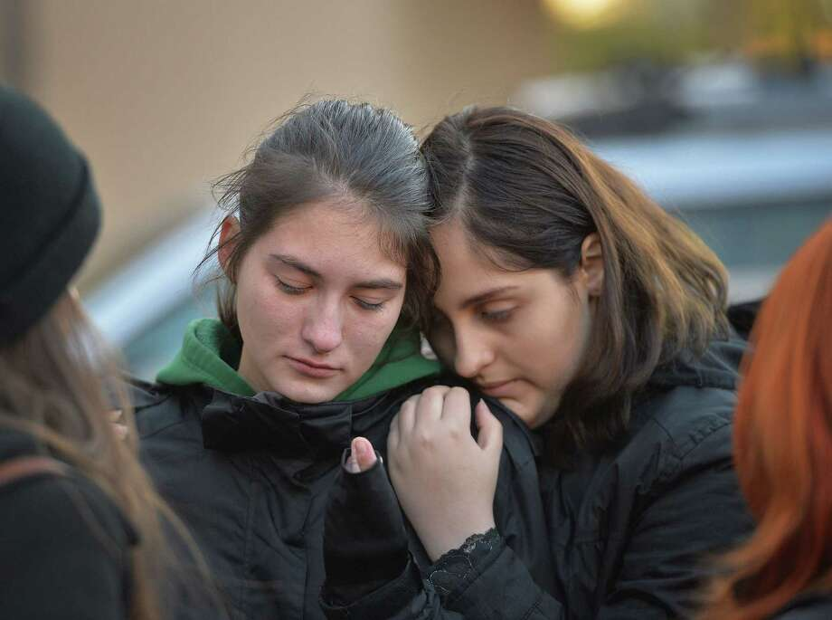 Two young women mourn a victim at a memorial makeshift outside the nightclub Colectiv in Bucharest. At least 27 people were killed. Photo: Daniel Mihailescu /Getty Images / AFP