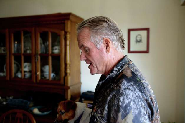 Ralph Perrott is pictured at his Latham home Friday, Oct. 30, 2015, in Colonie, N.Y. Perrott, who has a mentally ill daughter in Albany, is worried that she could end up in an encounter with police that would be similar to the Dontay Ivy incident. Perrott, a retired air force sergeant, is planned to join protesters Friday night. (Will Waldron/Times Union) Photo: Will Waldron / 00034017A
