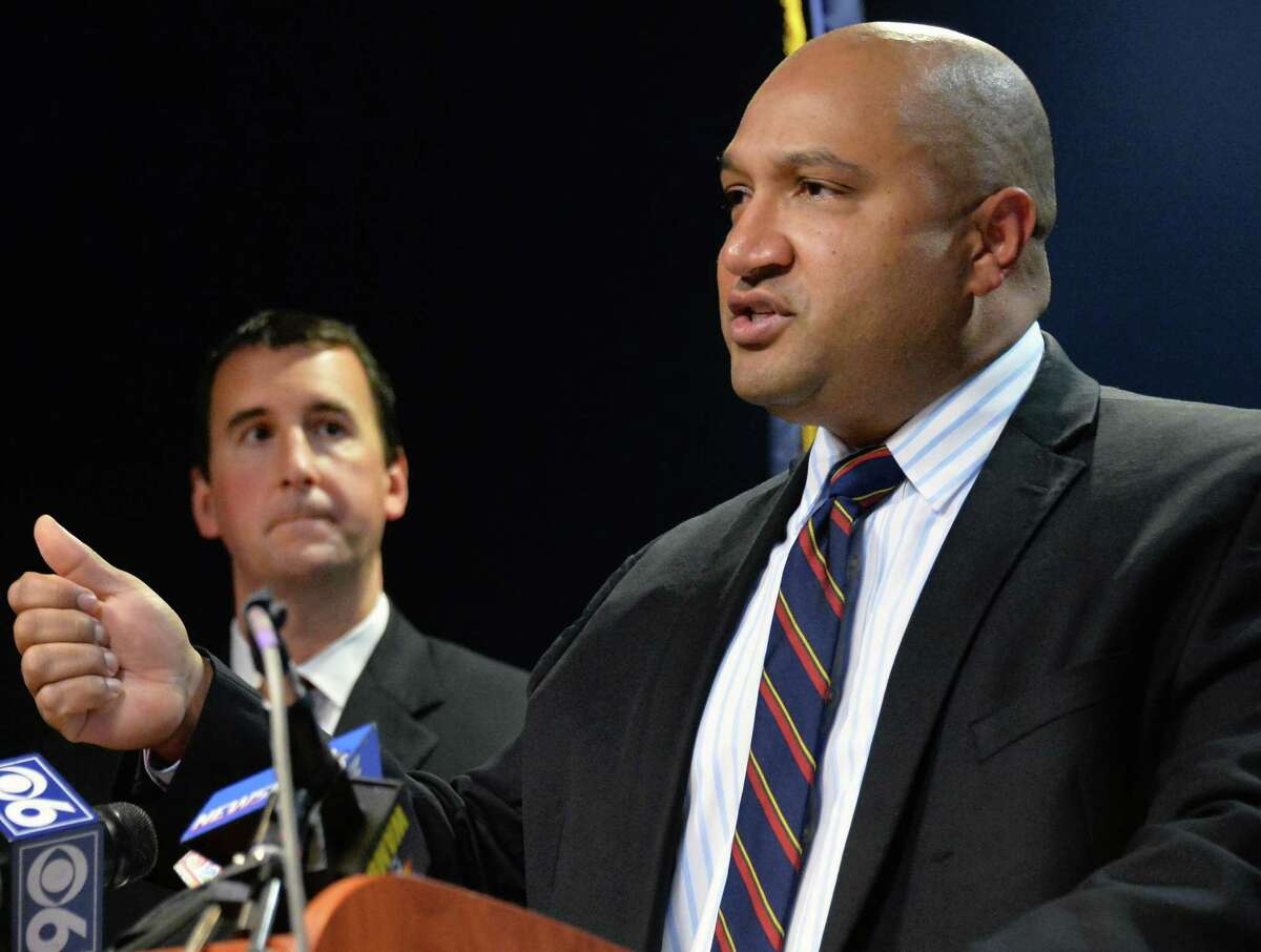 District Attorney P. David Soares announces the Grand Jury's findings about the Donald iDontayi Ivy death during a news conference Wednesday Oct. 28, 2015 in Albany, NY. At left is chief asst. DA Dave Rossi. (John Carl D'Annibale / Times Union) ORG XMIT: MER2015102814390918