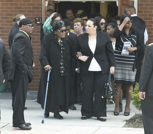 """Mourners leave the Greater St. John's Church Monday morning April 13, 2015 in Albany, N.Y. after the funeral ceremony of Donald """"Dontay"""" Ivy.    (Skip Dickstein/Times Union) ORG XMIT: MER2015041315292481 Photo: SKIP DICKSTEIN / 00031346A"""