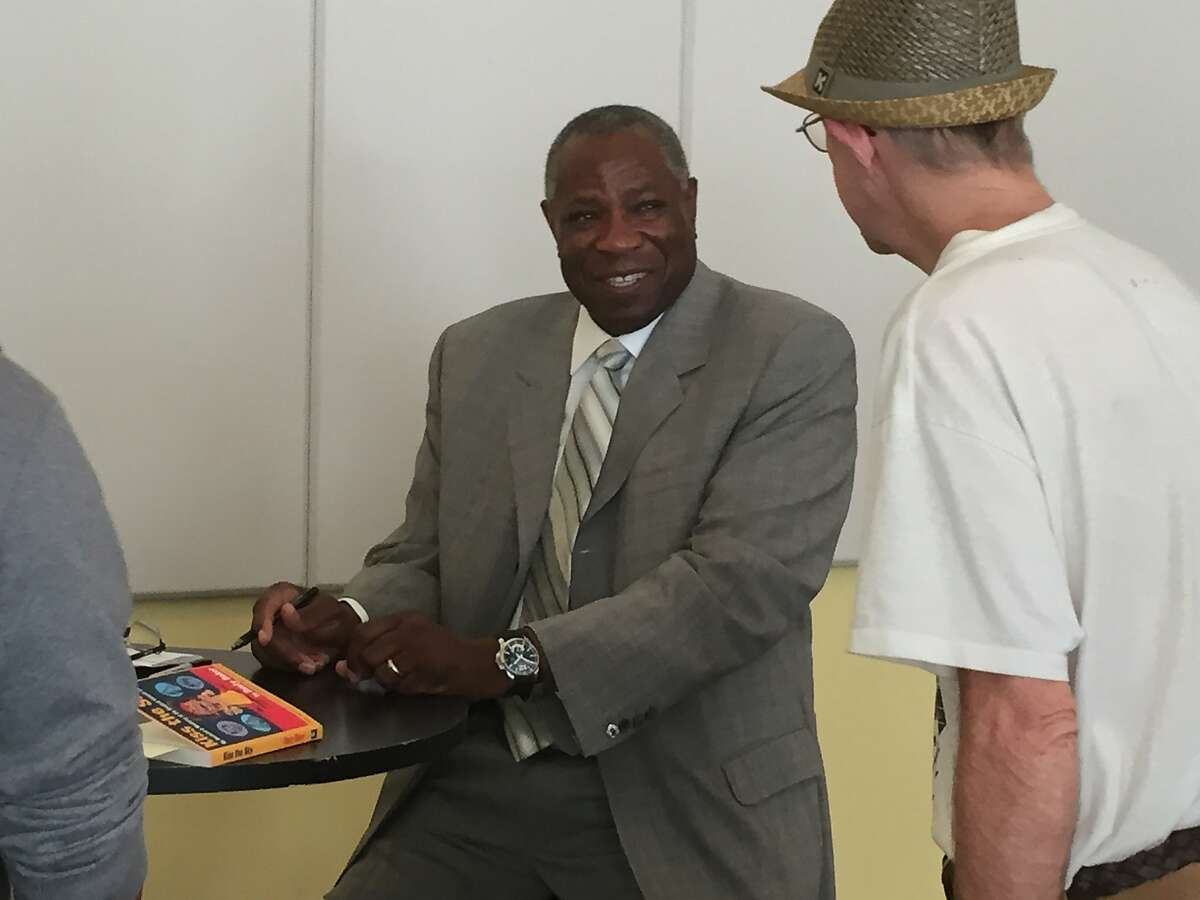 """Dusty Baker signs copies of his new book, """"Kiss the Sky,"""" at the Commonwealth Club in San Francisco."""