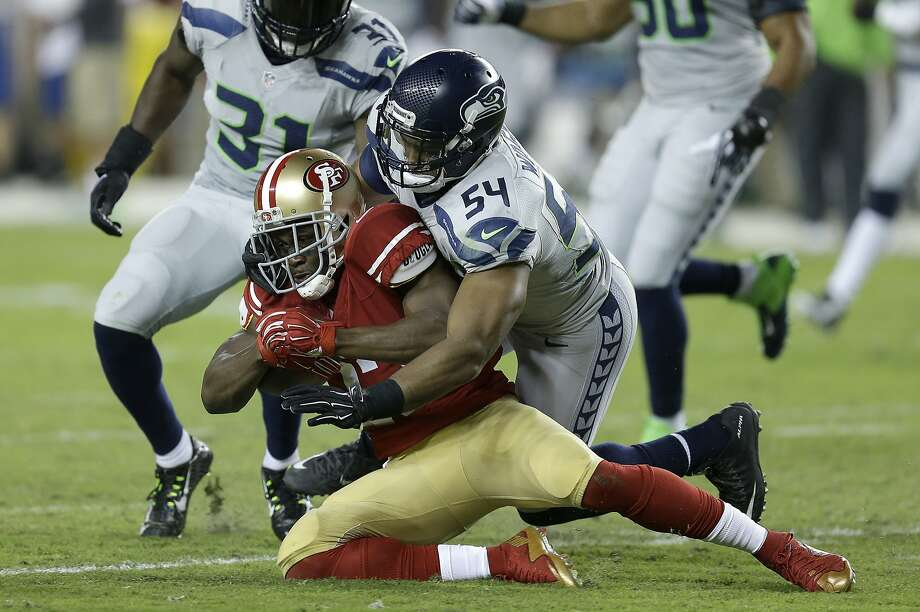 Seattle Seahawks middle linebacker Bobby Wagner (54) tackles San Francisco 49ers running back Reggie Bush during the second half of an NFL football game in Santa Clara, Calif., Thursday, Oct. 22, 2015. (AP Photo/Ben Margot) Photo: Ben Margot, Associated Press