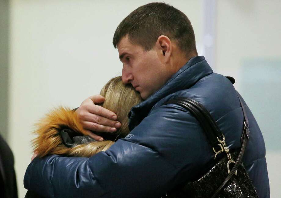 Relatives react after a Russian airliner with 217 passengers and seven crew aboard crashed, as people gather at Russian airline Kogalymavia's information desk at Pulkovo airport in St.Petersburg, Russia, Saturday, Oct. 31, 2015. Russia's civil air agency is expected to have a news conference shortly to talk about the Russian Metrojet passenger plane that Egyptian authorities say has crashed in Egypt's Sinai peninsula.(AP Photo/Dmitry Lovetsky) Photo: Dmitry Lovetsky, STF / Associated Press / AP