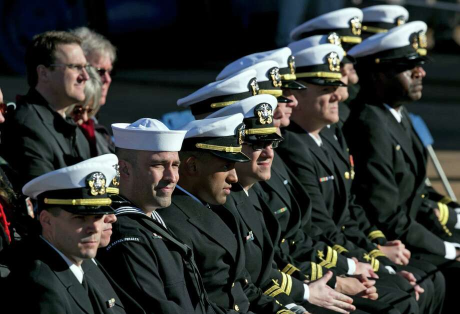 Prospective sailors attend the christening ceremony for the USS Raphael Peralta, at Bath Iron Works, Saturday, Oct. 31, 2015, in Bath, Maine. The warship is named for Rosa Peralta's son, Sgt. Raphael Peralta, who was killed in action on Nov. 15, 2004, while clearing houses in the city of Fallujah, Iraq, during Operation Al Fajr. (AP Photo/Robert F. Bukaty) Photo: Robert F. Bukaty, STF / Associated Press / AP