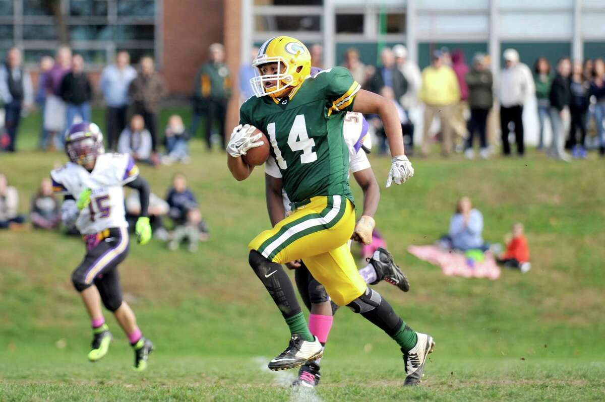 Trinity Catholic tight end Gerardo Gonzalez runs towards the end zone during a game against Westhill on Oct. 31, 2015 in what was Trinity's last home game on the grass field.