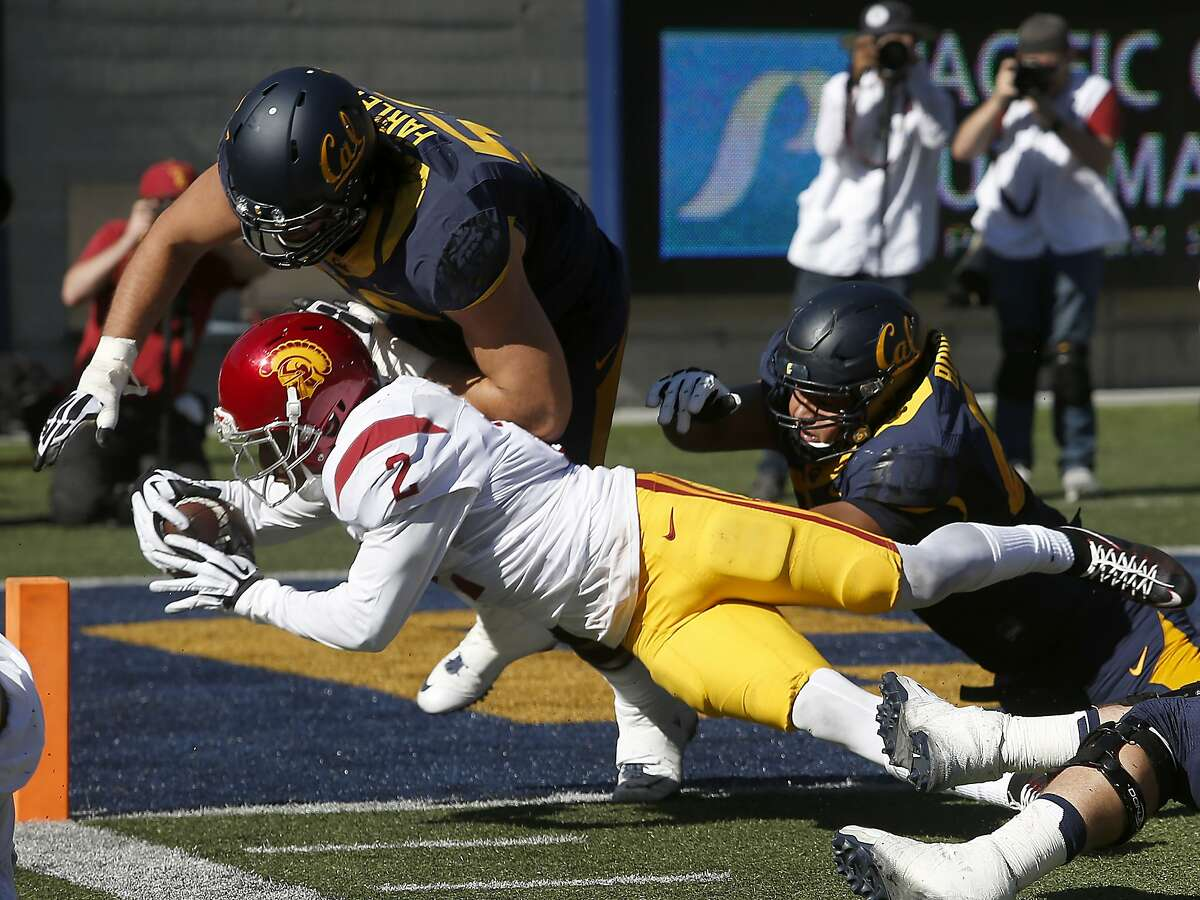 USC cornerback Adoree' Jackson dives across the goal line to score on an interception in the 3rd quarter of the Cal Bears game against the USC Trojans at Memorial Stadium in Berkeley, Calif. on Saturday, Oct. 31, 2015.