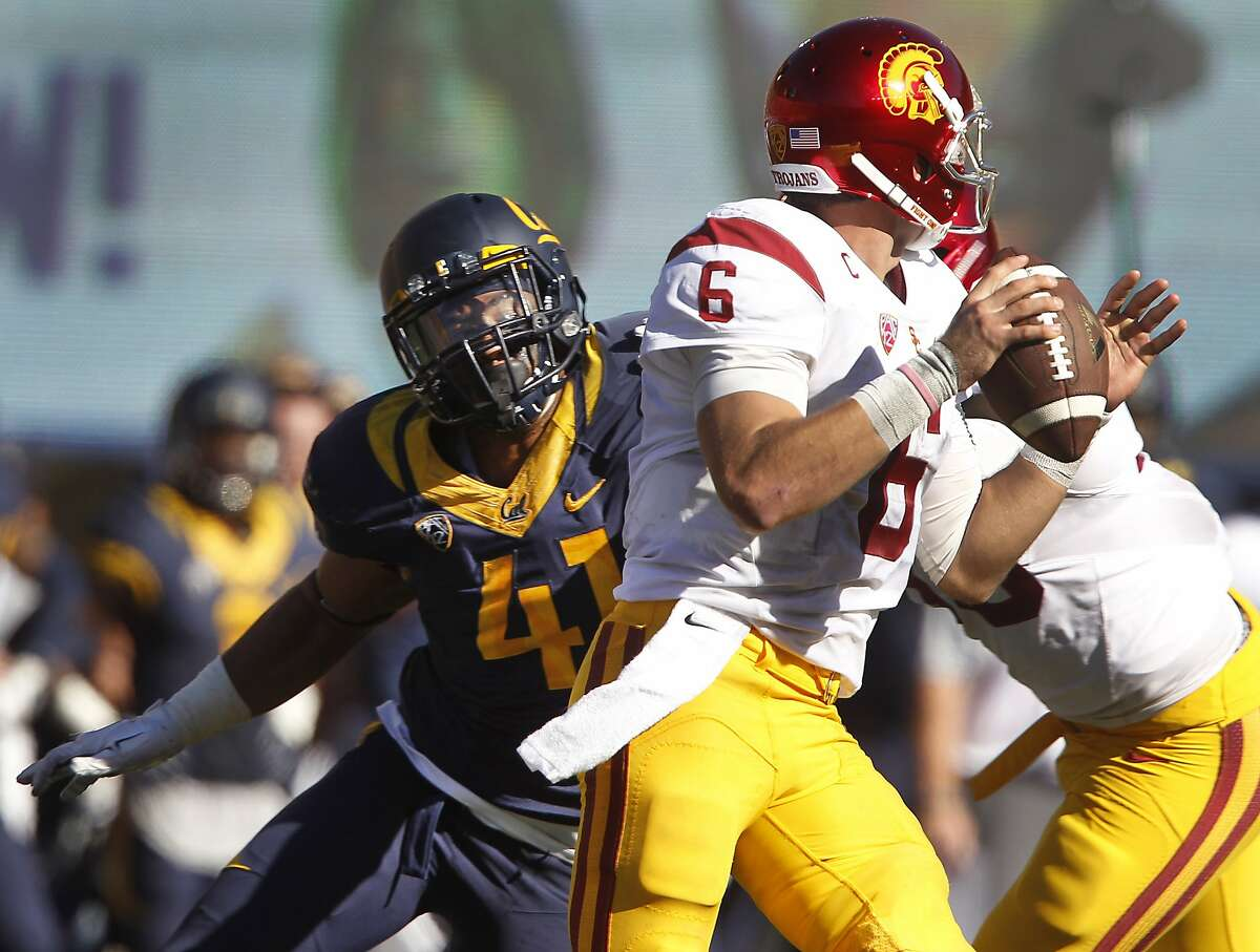 USC quarterback Cody Kessler is set to pass under pressure from Cal's Todd Barr in the second half of the Cal Bears game against the USC Trojans at Memorial Stadium in Berkeley, Calif. on Saturday, Oct. 31, 2015.