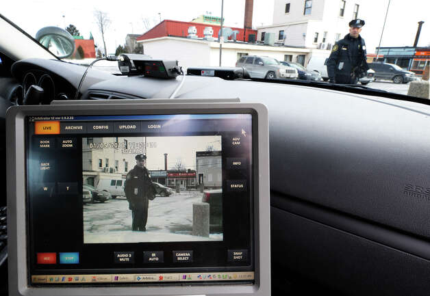 Albany Police Officer William Wilson is captured on the video screen by the new police camera on board his cruiser in Albany, New York  January 5, 2010.     (Skip Dickstein/Times Union) Photo: Skip Dickstein / 2008