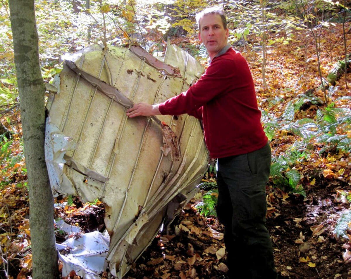 Scott van Laer unearths airplane wreckage from a 30-year-old crash site Monday, Oct. 27, 2015, in the Adirondacks. (Rick Karlin/Times Union)