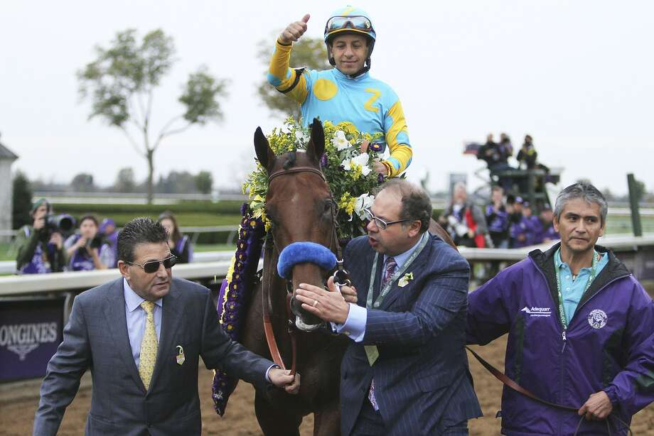 American Pharoah owner Ahmed Zayat pats the horse as jockey Victor Espinoza rides into the winner's circle after winning the Breeders' Cup Classic horse race at Keeneland race track Saturday, Oct. 31, 2015, in Lexington, Ky. (AP Photo/Garry Jones) Photo: Garry Jones, Associated Press