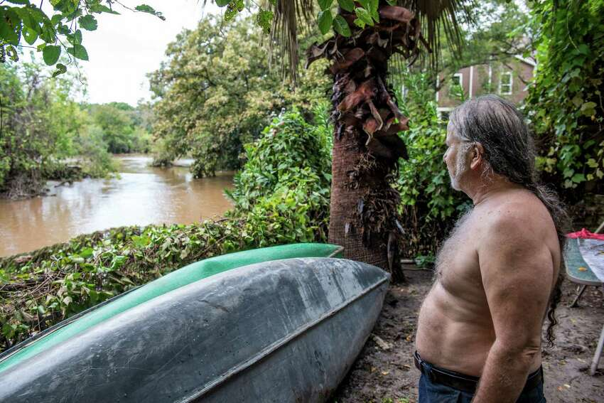 Brian Archer survey's the San Marcos river from his backyard after heavy rainfall caused flooding in his neighborhood in central Texas on Saturday, October 31, 2015. Archer refers to the area as