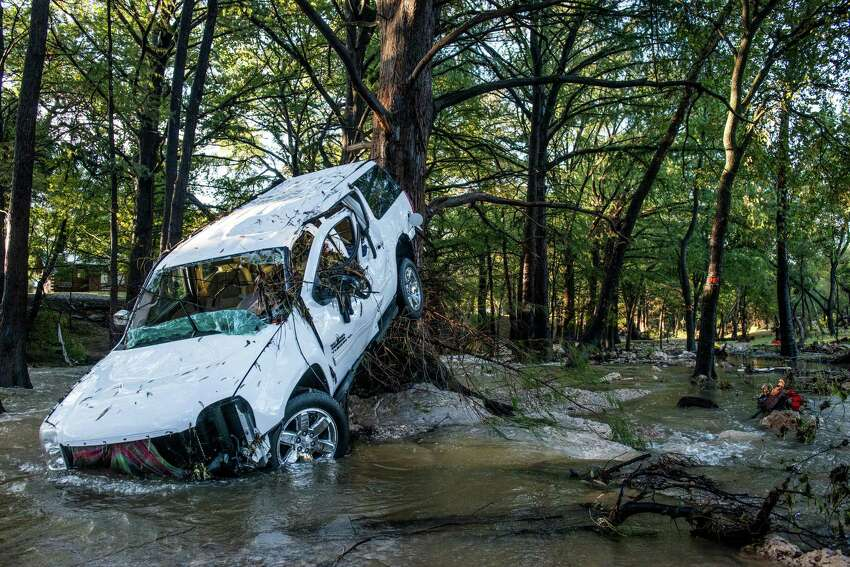 A car is left at Cypress Creek in Wimberley as the water recedes after heavy rainfall caused flooding of the rivers of central Texas on Saturday, October 31, 2015.