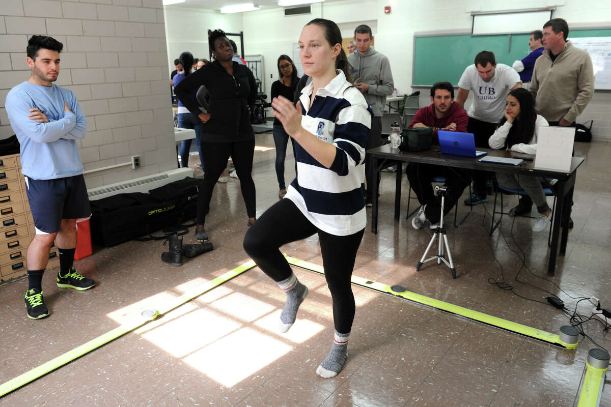 Lauren Zolnowsky, a first year Chiropractic student from Montclair, NJ marches in place during biomotor skills testing at the University of Bridgeport, in Bridgeport, Conn. Oct. 27, 2015.