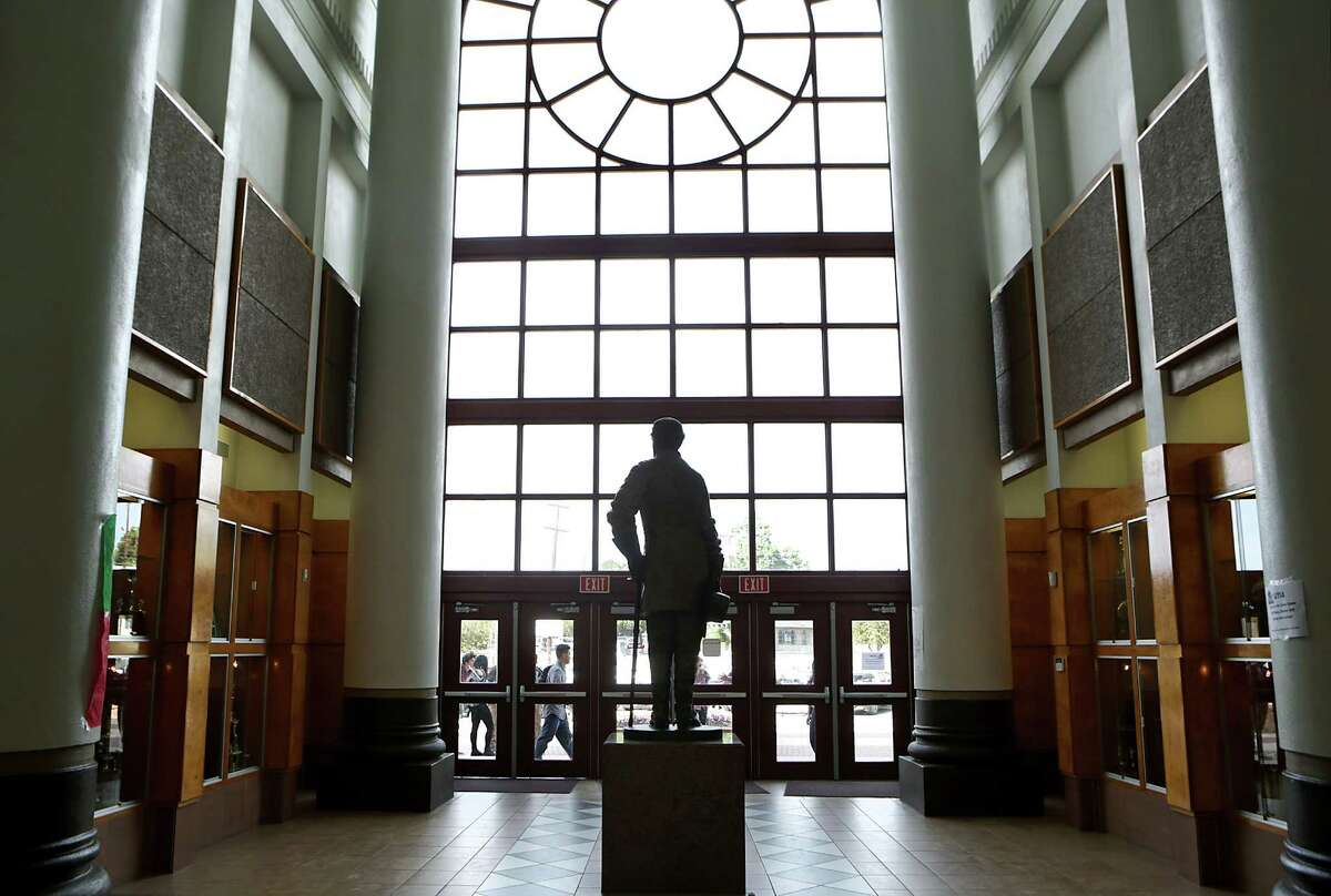 A statue of Robert E. Lee faces out to the entrance of Lee High School. The NEISD board voted 5-2 against a proposal to change the school's name but will take inventory of Confederate symbols displayed at the school for possible further action.