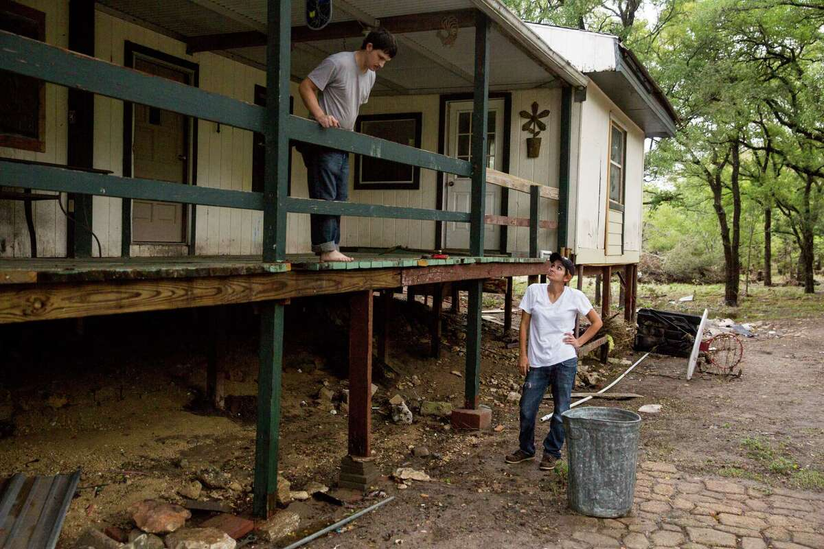 Jarrell and Glenda Bamberger examine their old home Friday. It had flooded during Memorial Day weekend.