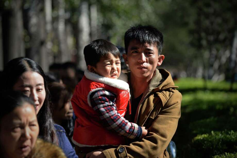 A government researcher estimates at least 6.5 million Chinese lack official status for being born outside of family planning rules. Photo: Wang Zhao /Getty Images / AFP or licensors