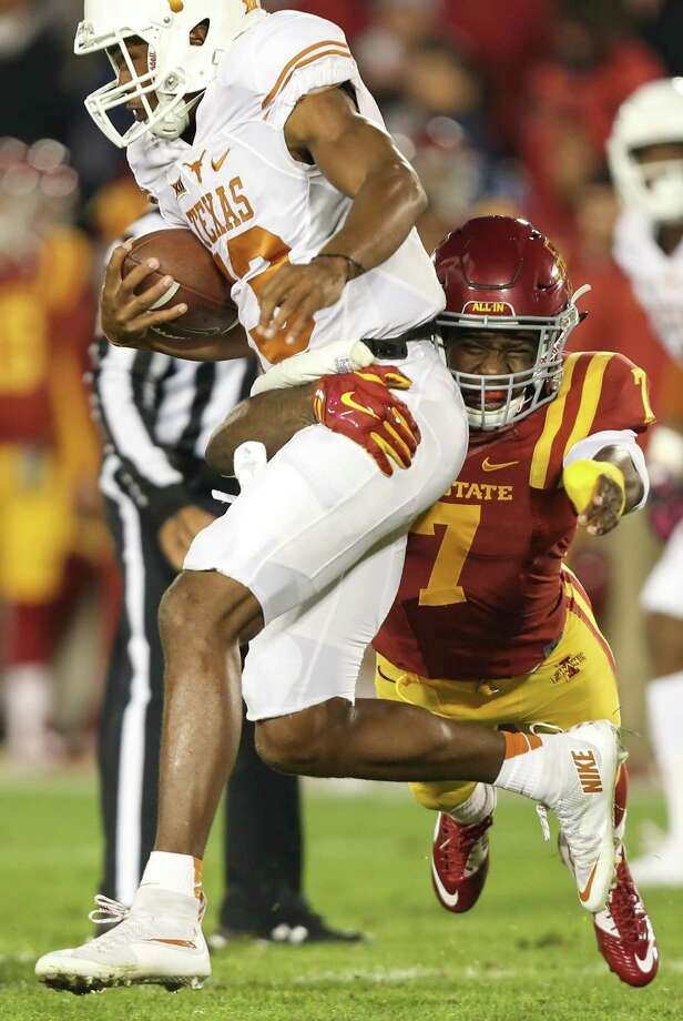 Texas quarterback Jerrod Heard, left, is tackled by Iowa State defensive back Qujuan Floyd during the first half of an NCAA college football game, Saturday, Oct. 31, 2015, in Ames, Iowa. (AP Photo/Justin Hayworth) Photo: Justin Hayworth, Associated Press / FR170760 AP