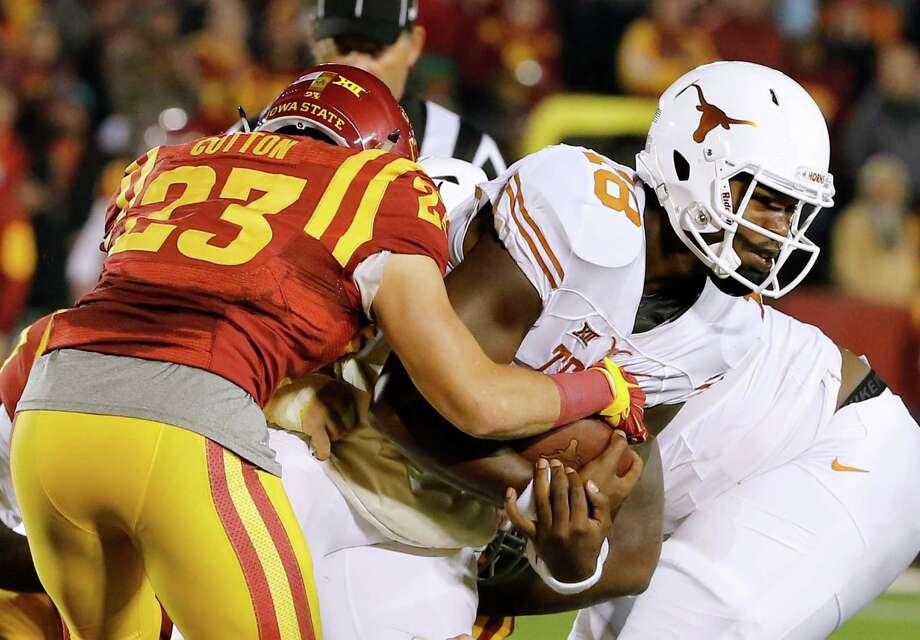 Iowa State's Darian Cotton tackles Texas QB Tyrone Swoopes in the first half Saturday night. Photo: David Purdy /Getty Images / 2015 Getty Images
