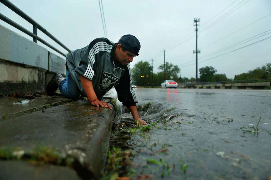 More than 115,000 storm drains are up for adoption at Houstonadoptadrain.org. Photo: Mark Mulligan, Houston Chronicle / © 2015 Houston Chronicle