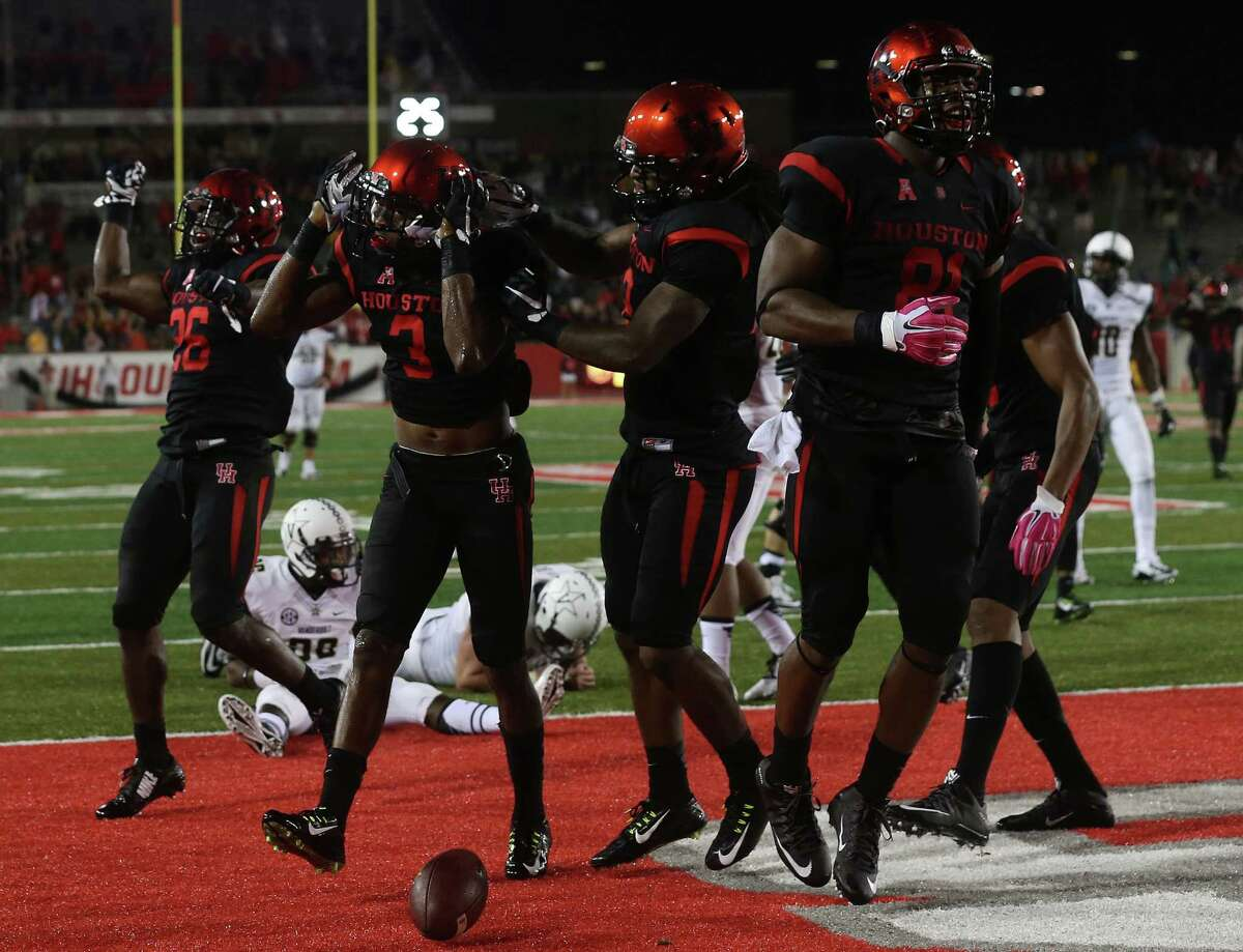 Houston Cougars cornerback William Jackson III (3)celebrates with his team after running in an intercepted pass in the third against Vanderbilt on Saturday, Oct. 31, 2015, in Houston. Houston won the game 34-0. ( Elizabeth Conley / Houston Chronicle )