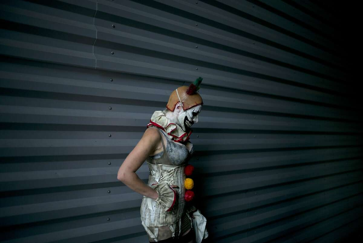 A woman dressed as a clown poses during a photo session at Stan Lee's Comikaze Expo at the Los Angeles Convention Center, Saturday, Oct. 31, 2015, in Los Angeles.
