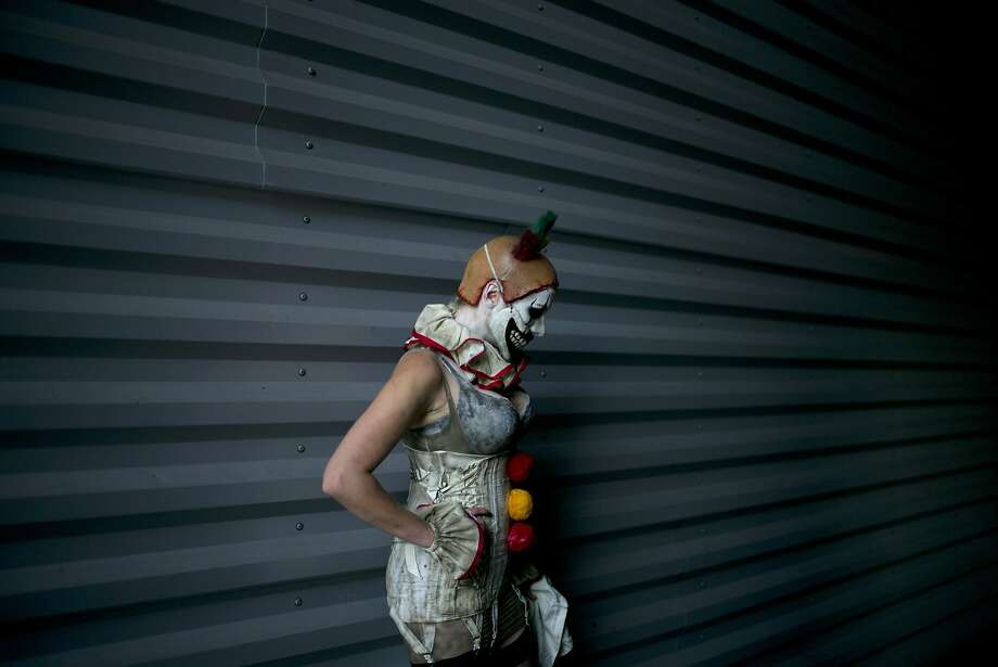 A woman dressed as a clown poses during a photo session at Stan Lee's Comikaze Expo at the Los Angeles Convention Center, Saturday, Oct. 31, 2015, in Los Angeles.  Photo: Jae C. Hong, Associated Press