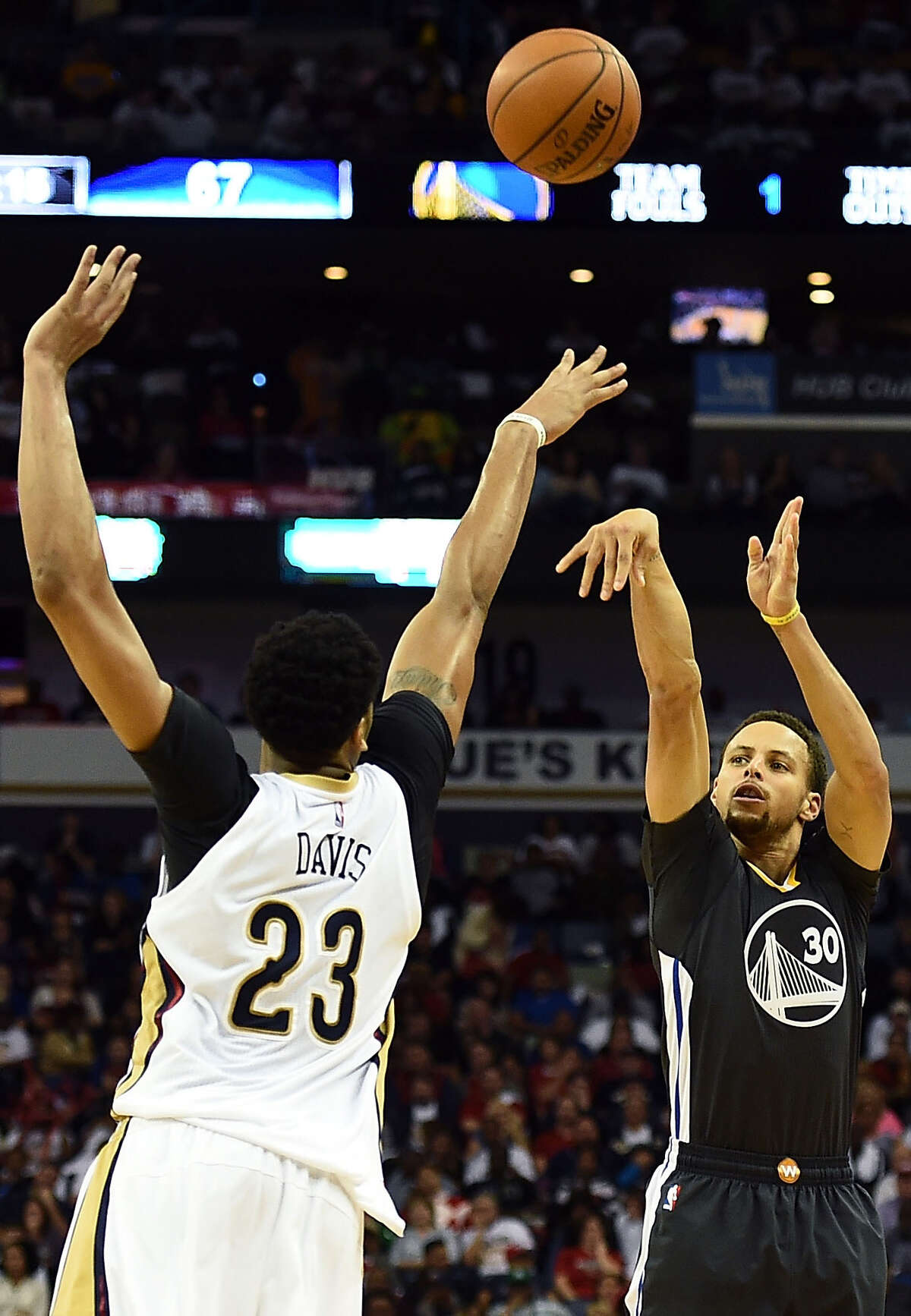NEW ORLEANS, LA - OCTOBER 31: Stephen Curry #30 of the Golden State Warriors takes a three point shot over Anthony Davis #23 of the New Orleans Pelicans during the second half of a game at the Smoothie King Center on October 31, 2015 in New Orleans, Louisiana. NOTE TO USER: User expressly acknowledges and agrees that, by downloading and or using this photograph, User is consenting to the terms and conditions of the Getty Images License Agreement. (Photo by Stacy Revere/Getty Images)