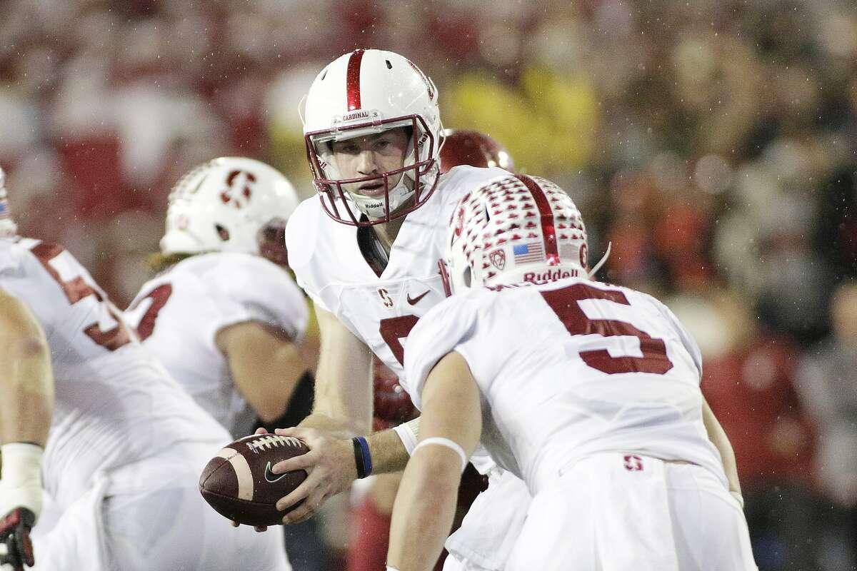 Stanford quarterback Kevin Hogan hands off to running back Christian McCaffrey, who ran for 107 yards.
