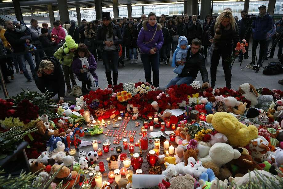Mourners leave tributes to crash victims at Pulkovo International Airport outside St. Petersburg, Russia. Photo: Dmitry Lovetsky, Associated Press