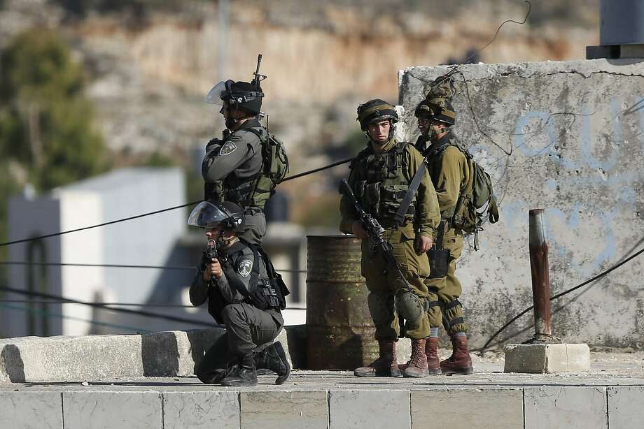 Israeli troops patrol near the scene of a stabbing attempt in the West Bank city of Hebron. Photo: Nasser Shiyoukhi, Associated Press