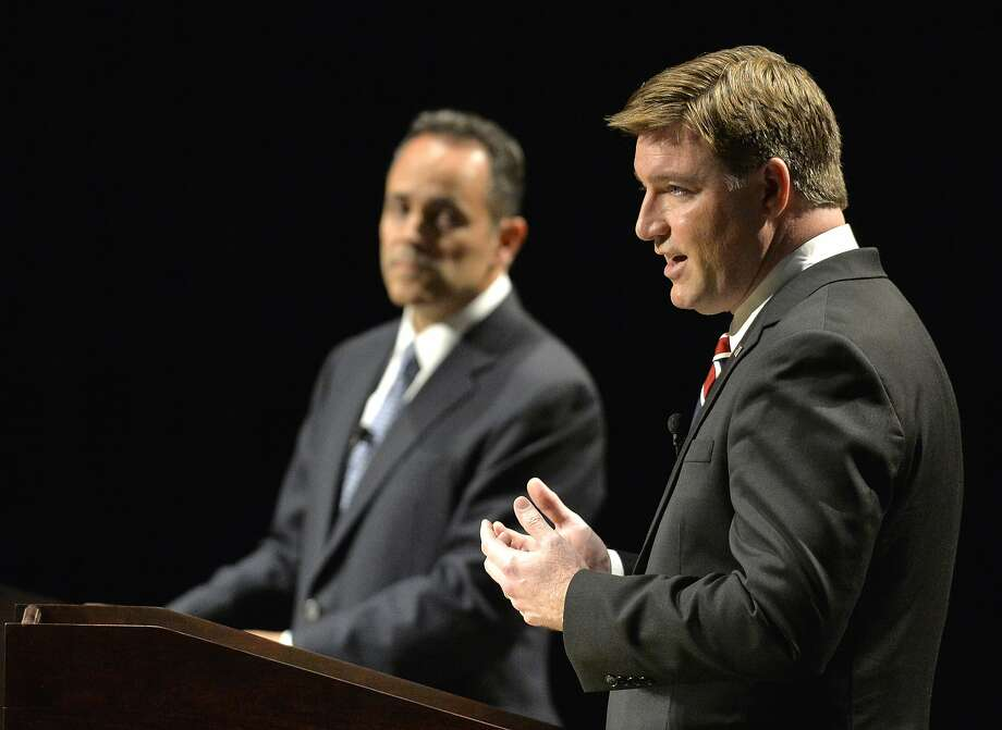 Kentucky Democratic gubernatorial candidate Jack Conway, right, responds to a question as Republican candidate Matt Bevin looks on during the League of Women Voters debate, Sunday, Oct. 25, 2015, in Richmond, Ky. (AP Photo/Timothy D. Easley) Photo: Timothy D. Easley, Associated Press