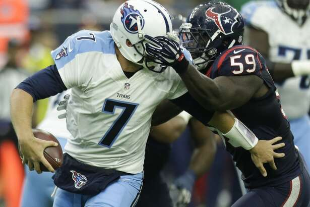 Houston Texans outside linebacker Whitney Mercilus (59) gets called for a personal foul after grabbing the face mask of Tennessee Titans quarterback Zach Mettenberger (7) as he sacks him during the second quarter of an NFL football game at NRG Stadium on Sunday, Nov. 1, 2015, in Houston. ( Brett Coomer / Houston Chronicle )